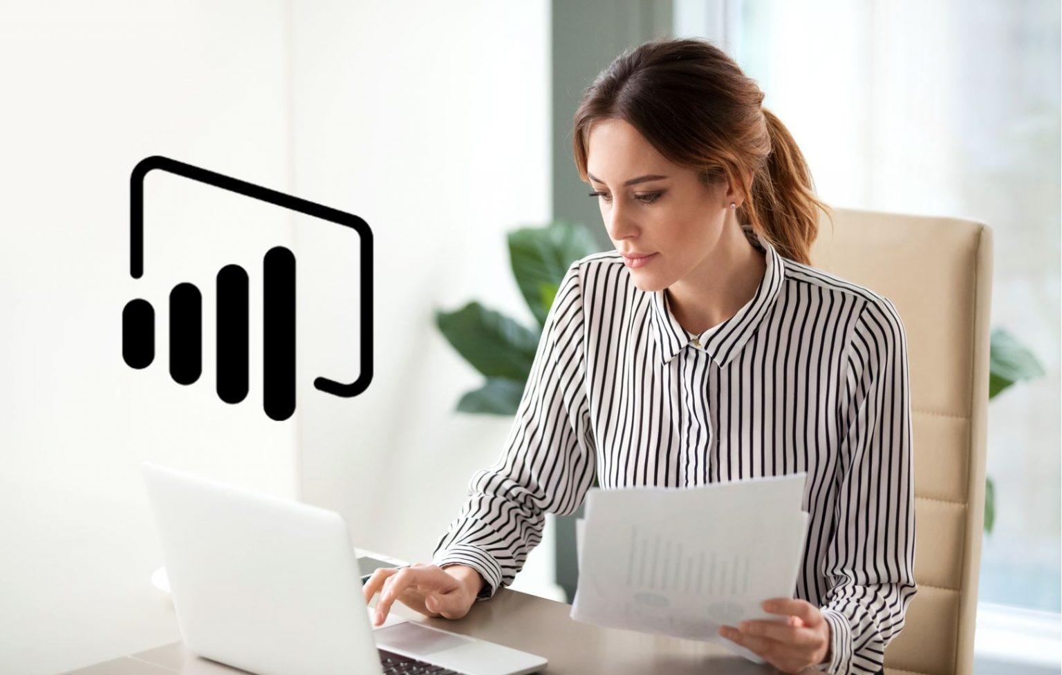 business woman works on laptop with power BI logo