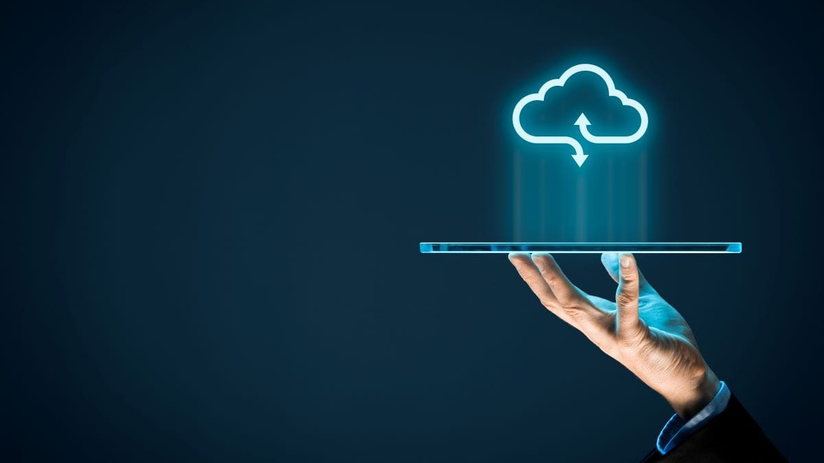 person holding tablet with cloud icon