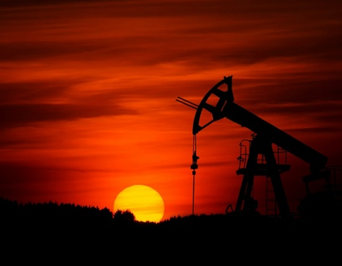 oil pump jack in sunset