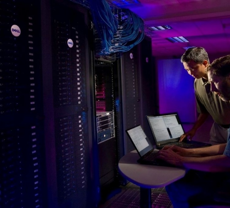 two IT employees work in server room